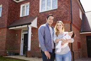 young-couple-with-baby-buy-new-house